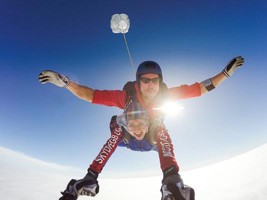Skydive freefall with sun shining