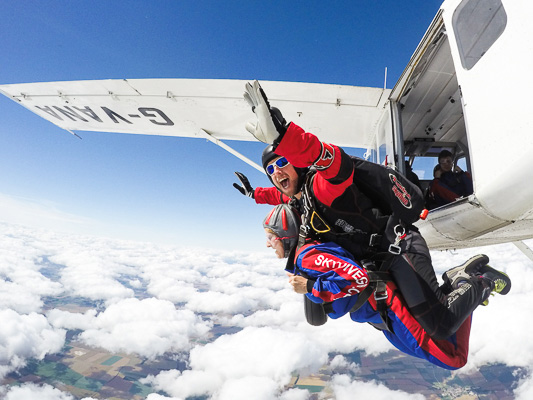 Skydiver jumping from plane