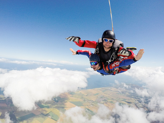 Skydive freefall with flamborough head in background